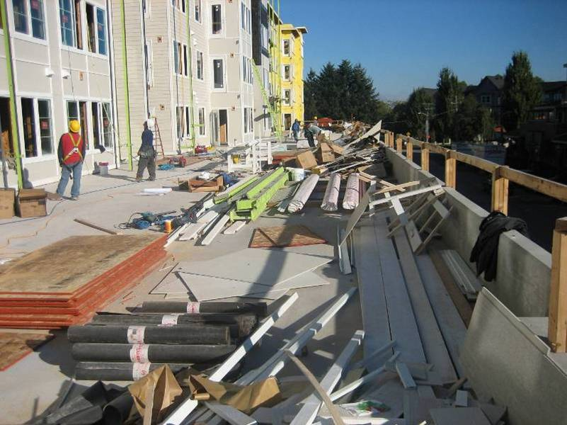 Membrane waterproofing is easily damaged during construction. When Hycrete integral waterproofing is used, there's no risk of damage, and plazas and podium decks can be used as laydown areas like shown above at Avalon Meydenbauer, Bellevue, WA