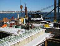 Pier in Maine, with Hycrete corrosion protection. In the splash zone, salt water is constantly sucked in to the concrete. Hycrete protects against both water ingress and pier corrosion.